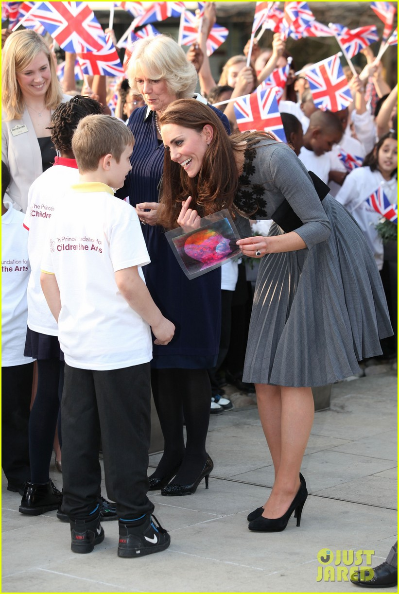 LONDON, ENGLAND - MARCH 15:  Catherine, Duchess of Cambridge and Camilla, Duchess of Cornwall speak with children as they leave The Dulwich Picture Gallery on March 15, 2012 in London, England. Prince Charles, Prince of Wales is to introduce Catherine, Duchess of Cambridge to the work of the Prince's Foundation for Children and The Arts.  (Photo by Tim Whitby/Getty Images)