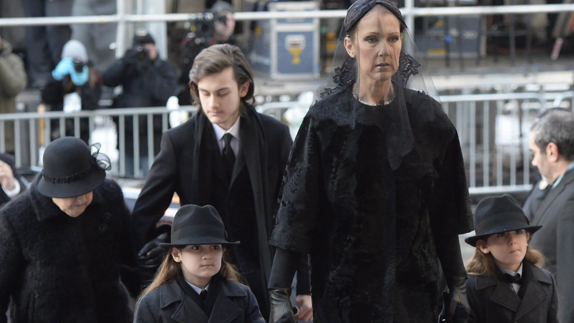 Celine Dion arrives with sons Eddy and Nelson at Montreal's Notre-Dame Basilica on Friday, January 22, 2016 for the funeral of her late husband Rene Angelil, who died of throat cancer last week at the age of 73. THE CANADIAN PRESS/Ryan Remiorz