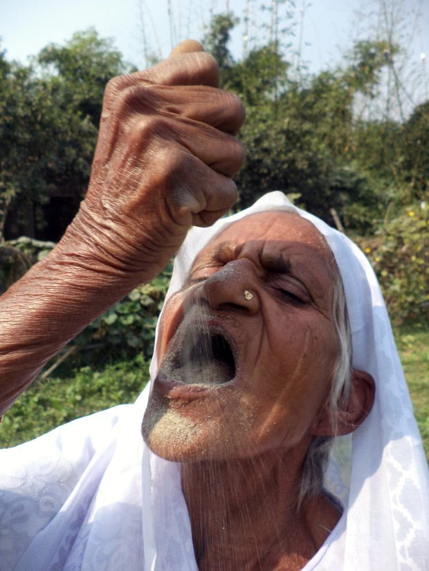 PIC FROM Caters News - (PICTURED: Kusma Vati, 78 eating sand) - An elderly woman from Varanasi, India, has eaten sand and gravel for the last six decades and claims the unique diet has been key to her good health. Kusma Vati, 78, is so addicted to eating sand and gravel that she spends hours in search of her staple diet and if she has no luck, she will even nibble on the walls of her own house. Her bizarre taste for stone has stunned everyone in her area of the city yet the granny claims it is because of sand and gravel that she has never felt sick. SEE CATERS COPY.