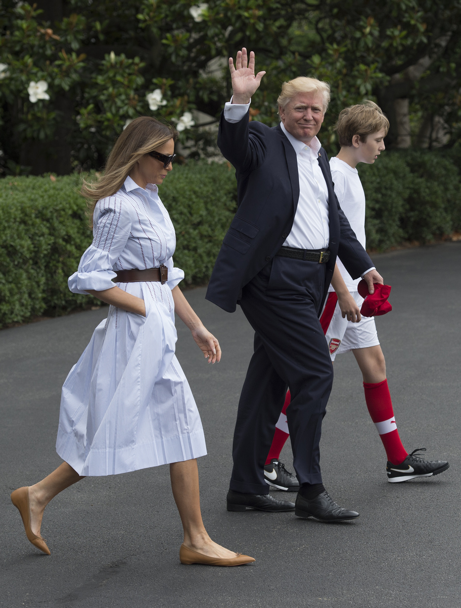 US President Donald J. Trump walks to Marine One with first lady Melania and their son Barron, as they depart the White House for Camp David, in Washington, DC, USA, 17 June 2017.